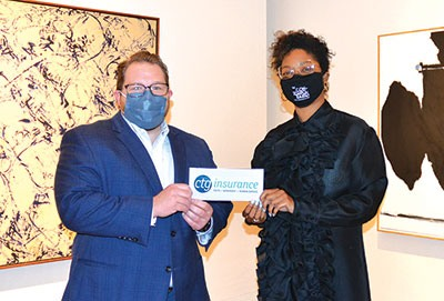 Anton Thornquist, President of CTG Insurance, presents Marissa Pierce, Acting Director of Development, with a check for sponsorship of The Contemporaries for another three years.