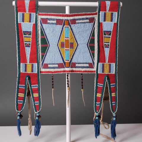 Crow, Montana, American. Martingale (Horse Ornament), ca. 1885. Deerskin, canvas, glass beads, and brass bells. 39 5/8 × 16 1/2 in. Gift of Mr. and Mrs. Richard Pohrt 1985.102