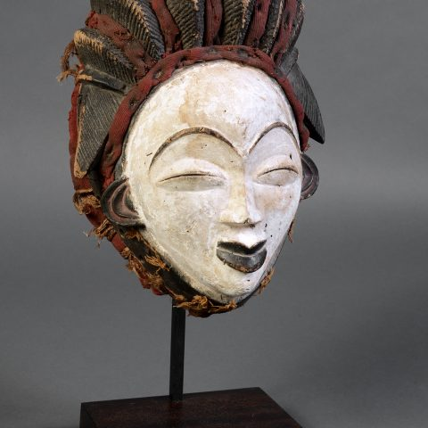 Punu peoples Gabon Ancestral Mask, 1927 Wood with black, white (kaolin) and red pigment, leather, and fabric 12 3/4 × 8 3/4 × 7 1/4 in. Gift of Genevieve and Richard Shaw, by exchange 2011.319